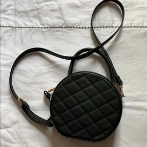 Round black handbag